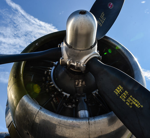 """The """"Madras Maiden"""" was one of the last B-17s manufactured and never saw combat. The aircraft is powered by four engines, each fitted with three large propellers, transporting the heavy bomber throughout Europe during WWII. Staff photo by Tyler Stewart"""