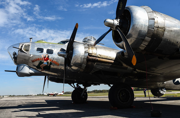 "A Boeing B-17, known as the ""Flying Fortress"",  awaits passengers before taking off from the Clark County Regional Airport on Monday. Manufactured in 1944 for use in WWII, the ""Madras Maiden"" is one of four remaining B-17s currently touring the nation. Staff photo by Tyler Stewart"