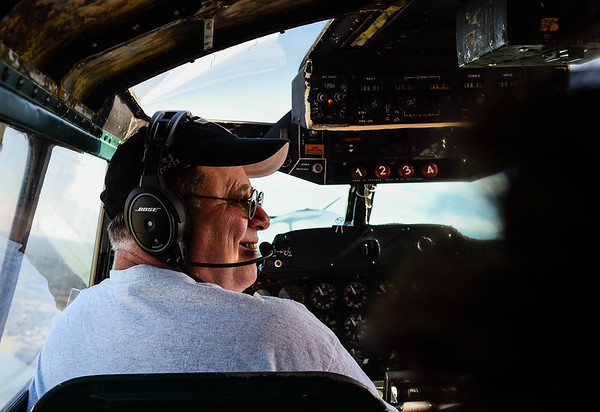 Pilot Bob Hill takes in the view over the Ohio River with his co-captain during a flight over Clark County as part of the Liberty Foundation's 2017 Salute to Veterans tour. Hill is a volunteer pilot with the Liberty Foundation, leading Monday's flight tour in the B-17 out of the Clark County Regional Airport. Staff photo by Tyler Stewart