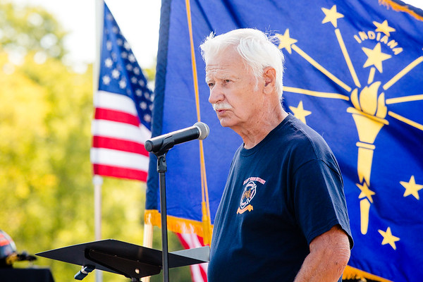 Retired Louisville Firefighter Vestal Rogers recites a poem he wrote during the 9/11 memorial service at Big Four Park on Sunday.