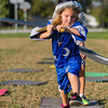 A young wizard, Loucie Hicks, 5, jumps from square to square, avoiding the grass, during a LARP adventure at Silver Street Park on Saturday.