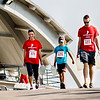 From left, Randi Lilly, Dominick Ragan, 8, and Jeremy Ragan carry five empty jugs of water down to the riverfront in New Albany during the Water:Walk.