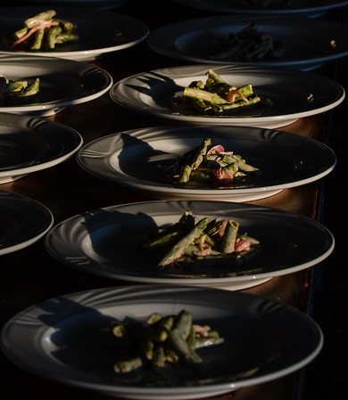 A fresh green bean salad, prepared by the Portage House,  is plated for guests of Saturday evening's Farm to Table dinner. Staff photo by Tyler Stewart
