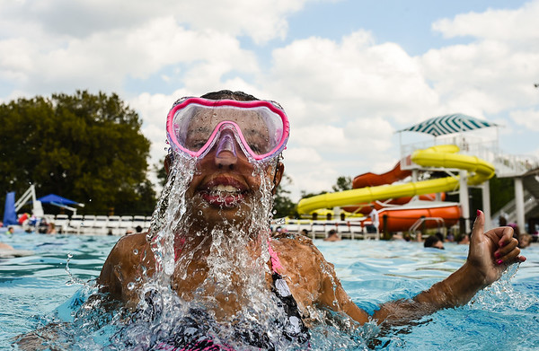 Aryan Masden, 11, bursts out of the shallow end while swimming with her family at the Clarksville Cove on Monday. While nearly all other public pools will be closed after the holiday weekend, the Cove and it's heated pool will remain open until October 1. Staff photo by Tyler Stewart