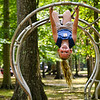 Kinsley Moreland, 6, hangs from a set of monkey bars while visiting Lapping Park with her family on Monday in Clarksville. Staff photo by Tyler Stewart