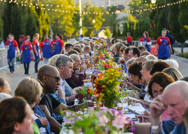 More than 150 guests attended Saturday evening's Farm to Table dinner along Chestnut Street in downtown Jeffersonville. Guests were treated to appetizers and three-course meal prepared by local eateries as part of the event. Staff photo by Tyler Stewart
