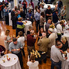 Attendees of Jeffersonville Main Street's Farm to Table dinner mingle in the lobby of 300 Spring during the social hour and appetizer samplings portion of the event on Saturday. Staff photo by Tyler Stewart
