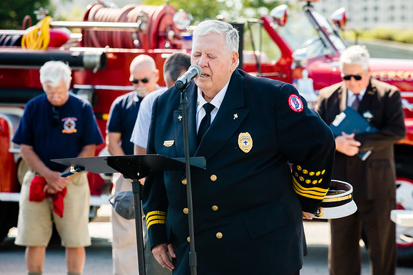 Indiana Volunteer Firefighter Association Chaplain Tom Sellmer delivers a prayer during the 9/11 memorial service at Big Four Park on Sunday.