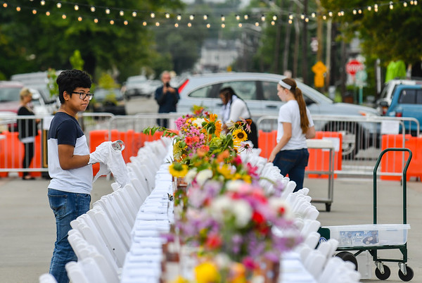 Jeffersonville High School Key Club member Vic Raksmey, 15, cleans glasses for guests of Saturday's Farm to Table event hosted by Jeffersonville Main Street. Staff photo by Tyler Stewart
