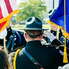 Jeffersonville Police Department's Major Joe Hubbard salutes the United States and Indiana flags during the 9/11 memorial service at Big Four Park on Sunday.