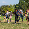 Children charge into battle during LARP in the Park at Silver Street Park on Saturday. Staff Photos By Josh Hicks