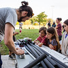 Geoff Runge teaches children how to make safe, padded weapons used in live action role playing battles during LARP in the Park at Silver Street Park on Saturday.