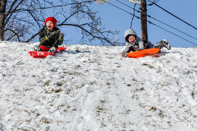 Brothers Kash Riley, 6, left and Blade Riley, 4, take off on a steep hill at the same time in Jeffersonville on Saturday.