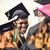 Giscard Ciney, a cyber security major, laughs with fellow graduates as they wait to enter the auditorium at Northside Christian Church for Ivy Tech's commencement ceremony. Staff photo by Tyler Stewart