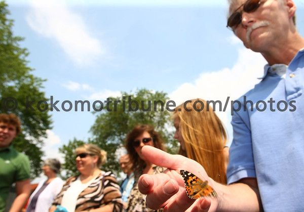 5-20-12<br /> Mark Evans with his wife Kathy and daughter Megan, 13, release butterflies at Birthright. Carrie Lupini said that the butterfly was chosen because it is a symbol of new life and hope for the girls who come into Birthright. This was a celebration for the 25th anniversary of Birthright in Kokomo.<br /> KT photo | Tim Bath