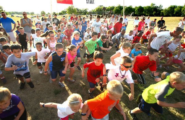 6-14-12<br /> Cyote Kids running event for kids at Jackson-Morrow Park.<br /> Start of the 1 mile fun run. the biggest race of the day.<br /> KT photo | Tim Bath