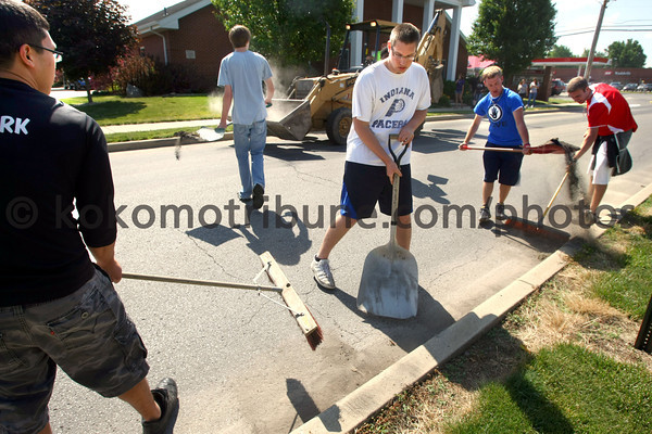 5-22-12<br /> Western HS seniors voluteer to clean up around the town of Russiaville on Tuesday. Calvin Park, Hayden Bowley, Andrew Van Auken, Zach Huffman and Aaron Hobbs sweap up piles of debree from the street curbs along Union Street.<br /> KT photo | Tim Bath