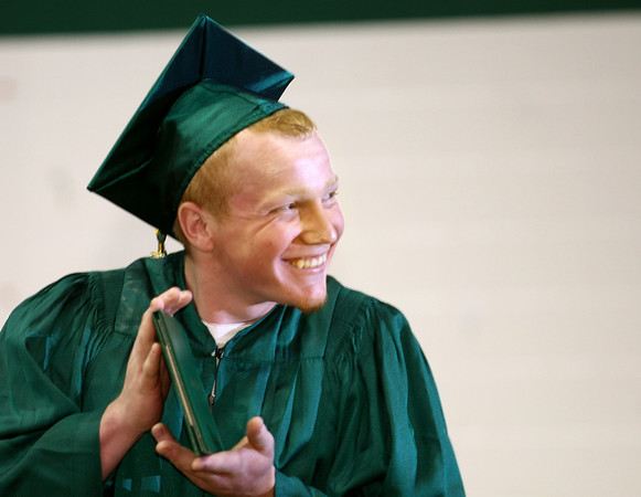6-3-12<br /> Eastern HS Graduation<br /> Jimmy Evans showing off his deploma after walking across the stage.<br /> KT photo | Tim Bath