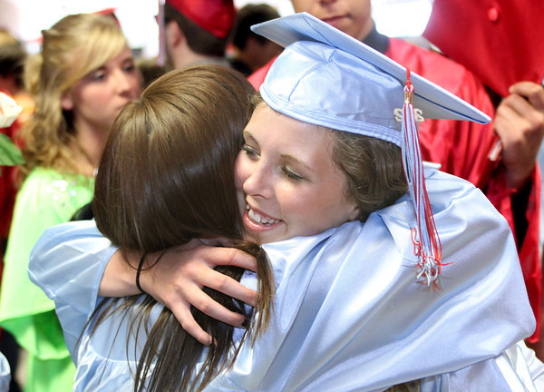 6-2-12   for the KT   Roger Davis<br /> Brittany May giving a hug to a classmate after ceremonies.