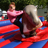 6-2-12<br /> Western Days in Russiaville<br /> Trista Wilson, 14, riding the mechanical bull at Western Days.<br /> KT photo | Tim Bath