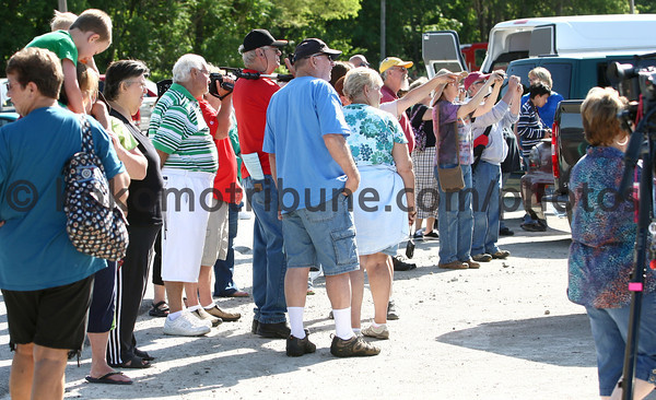 5-30-12<br /> Ringling Bros. and Barnum and Bailey Circus train stopped in Peru to fuel up, fill water and fix a generator. They also let the animals out for exercise and food. Hundreds stopped by the Norfolk Southern train yard to see the elephants on Wednesday.<br /> KT photo | Tim Bath