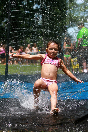 6-13-12<br /> Tamiya Sutton, 5, runs through fire hoses set up by The Kokomo Fire Department at Bon Air Park Wednesday afternoon.<br /> KT photo | Kelly Lafferty