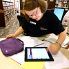 5-24-12<br /> The Kokomo Howard County Public Library now has iPads for checkout to those who qualify. Medora Kennedy points out some of the features on the iPad to a patron.<br /> KT photo | Tim Bath