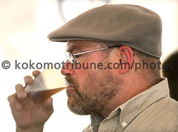 5-19-12<br /> Greatest Spectacle in Tasting.<br /> Dwayne Hendricks takes a sip of one of the beer samples.<br /> KT photo | Tim Bath