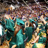 6-3-12<br /> Eastern HS Graduation<br /> Spraying silly string are Kendra Schnell and Amber Turnpaugh turner at the end of graduation.<br /> KT photo | Tim Bath