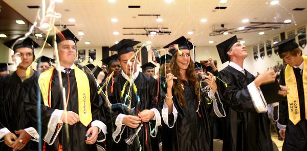 6-8-12<br /> Western HS Graduation<br /> John Baker, Garrett Beall, Riley Beatty, Sara Benzinger, Joel Bessler and Hayden Bewley pulling party poppers.<br /> KT photo | Tim Bath