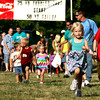 6-14-12<br /> Cyote Kids running event for kids at Jackson-Morrow Park.<br /> Lucy George, 3, running the 50 yard gallop with her brother Dylan George, 9, running along with her. He then ran his own race.<br /> KT photo | Tim Bath