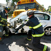 5-17-12<br /> Kokomo Firefighters use the jaws of life to remove the door of a white Malibu that was crunched between a school bus and a blazer at Sycamore and McCann on Thursday afternoon.<br /> KT photo | Tim Bath