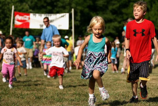 6-14-12<br /> Cyote Kids running event for kids at Jackson-Morrow Park.<br /> Lucy George, 3, running the 50 yard gallop with her brother Dylan George, 9, running along with her. He then ran his own race.<br /> KT photo   Tim Bath