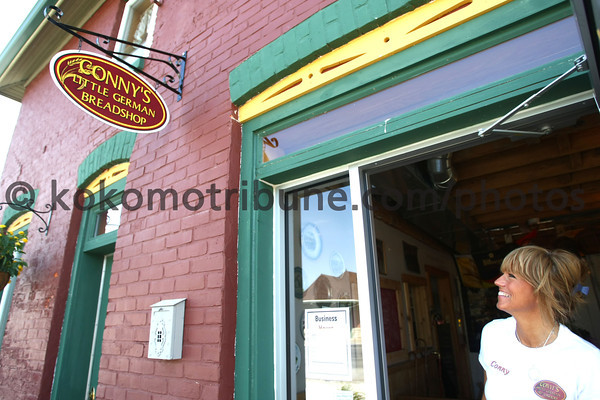 5-16-12<br /> ConnyÕs Little German Bakery 159 S. Broadway, Peru<br /> Conny Woodruff looking out the door of the bakery that is on the Wabash River.<br /> KT photo | Tim Bath