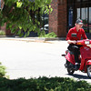 6-12-12<br /> The City of Kokomo has started requiring all scooter or moped owners to have a sticker purchased from the city.  Mike Wilson riding his scooter home from work.<br /> <br /> KT photo | Tim Bath