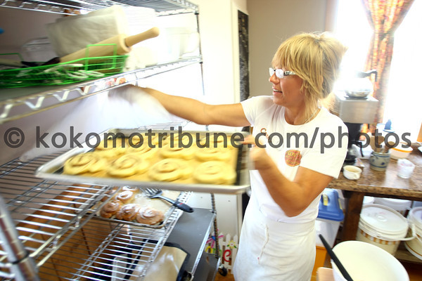 5-16-12<br /> ConnyÕs Little German Bakery 159 S. Broadway, Peru<br /> Conny Woodruff placing cinnamon rolls on a cooking sheet and putting them aside to rise.<br /> KT photo | Tim Bath