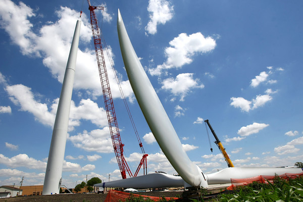 6-7-12<br /> Northwestern School Corporation's wind turbine being erected. The last section of the base is lowered into position.<br /> KT photo | Tim Bath