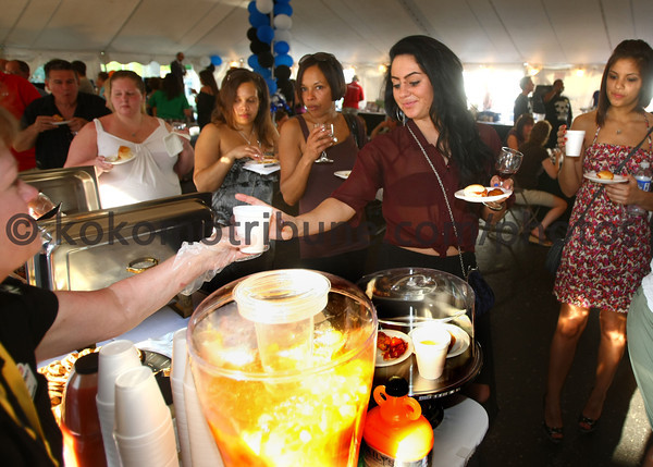 5-19-12<br /> Greatest Spectacle in Tasting.<br /> Brooke McNulty getting a drink from Sheila's Custom Catering.<br /> KT photo | Tim Bath