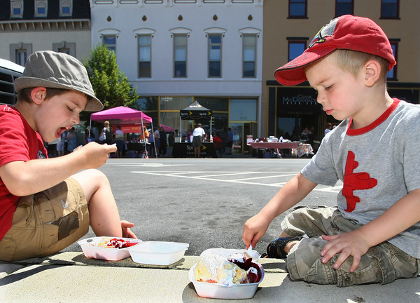 6-7-12<br /> Strawberry Festival downtown<br /> Seth Baldwin,8, and Griffin Baldwin-Mims, 3, eating strawberry shortcakes on the curb on Main Street.<br /> KT photo | Tim Bath