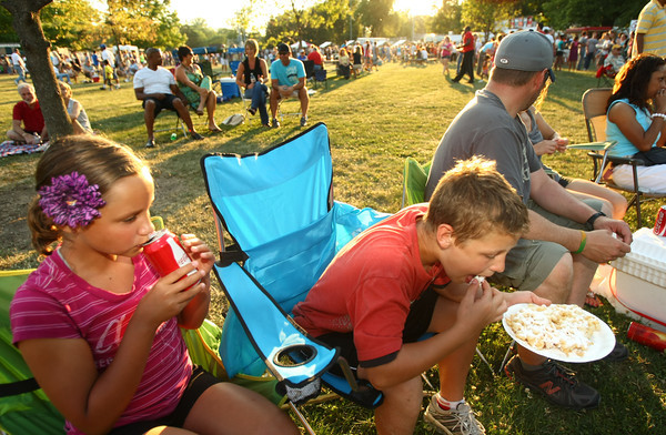6-9-12<br /> Ribfest at Foster Park<br /> Josie Geisner, 10 and brother Nathan Geisner, 12, eating a funnel cake and drinking coke.<br /> KT photo   Tim Bath