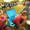 6-9-12<br /> Ribfest at Foster Park<br /> Josie Geisner, 10 and brother Nathan Geisner, 12, eating a funnel cake and drinking coke.<br /> KT photo | Tim Bath