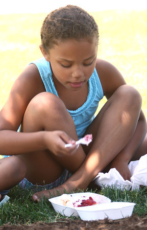 6-7-12<br /> Strawberry Festival downtown<br /> Brooklyn McKay, 6, eating strawberry shortcakes on the Courthouse lawn along Main Street.<br /> KT photo | Tim Bath