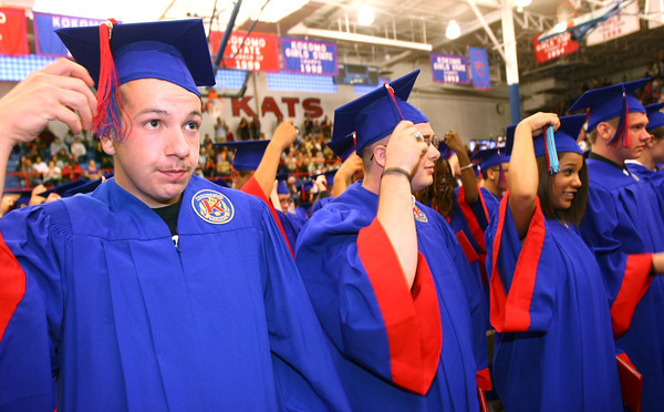 6-1-12<br /> KHS Graduation<br /> Shane Pell, Zachary Paul, Sarah Parry and Bryan Parks moving tassels.<br /> KT photo | Tim Bath