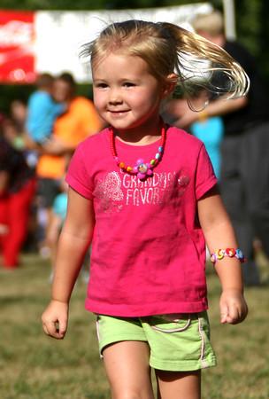 6-14-12<br /> Cyote Kids running event for kids at Jackson-Morrow Park.<br /> Annabella Beedham, 3, running the 50 yard dash.<br /> KT photo | Tim Bath