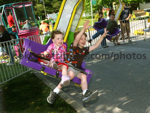 6-2-12<br /> Western Days in Russiaville<br /> Carli Hawley, 3, and brother Carter Hawley, 6, riging one of the rides at the yearly festival.<br /> KT photo | Tim Bath