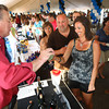 5-19-12<br /> Greatest Spectacle in Tasting. Jeff Wilcox serves a sample of wine to Beth Zirkle who was there with her husband Mark Zirkle.<br /> KT photo | Tim Bath