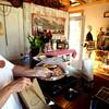 5-16-12<br /> ConnyÕs Little German Bakery 159 S. Broadway, Peru<br /> Sharon Armstrong loading a bag with cinnamon rolls.<br /> KT photo | Tim Bath