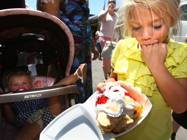 6-7-12<br /> Strawberry Festival downtown<br /> Aylah Sawyer, 4, eating strawberry shortcakes on Main Street.<br /> KT photo | Tim Bath