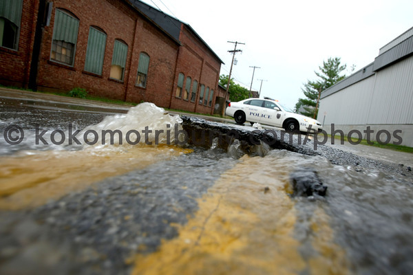 5-29-12<br /> Water main break along Vaile Ave between Ohio and Waugh on Tuesday morning.<br /> KT photo | Tim Bath