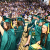 6-3-12<br /> Eastern HS Graduation<br /> Spraying silly string is Kendra Schnell with Amber Turnpaugh turner her tassle and Anthony Wood also spraying silly string at the end of graduation.<br /> KT photo | Tim Bath